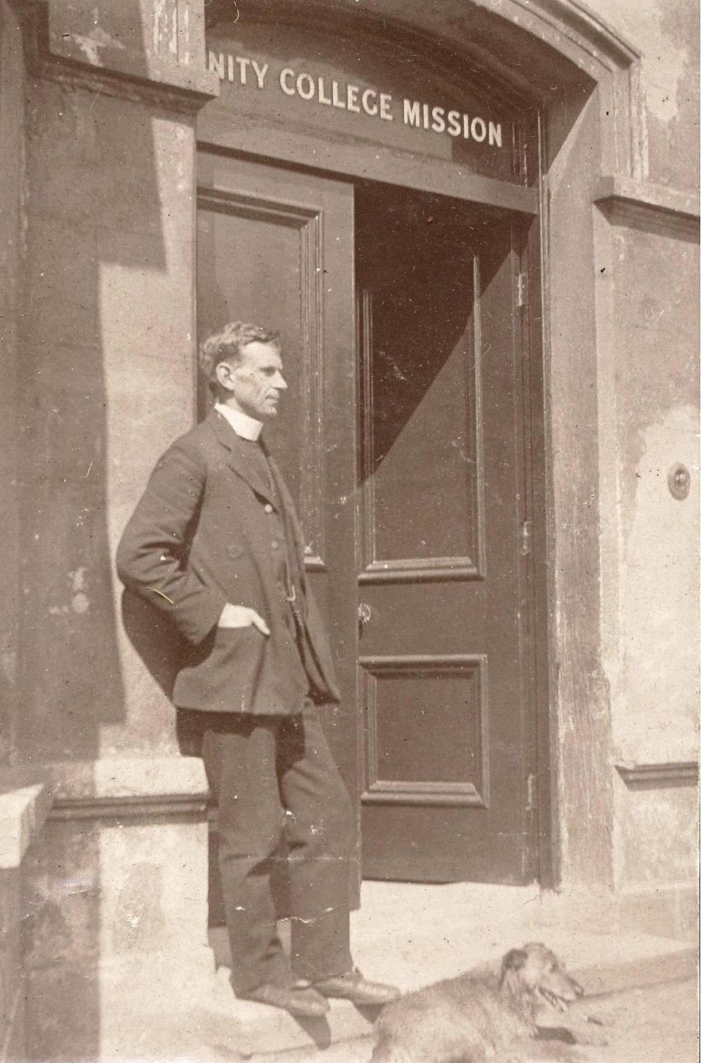 Revd Arthur Barton (1881-1962) Head of Mission 1912-14 at the door of the Trinity College Mission Belfast, RCB Library MS 295
