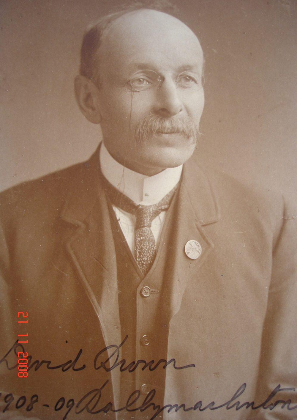 David Brown, co-director of the Donaghmore Soap Works, county Tyrone, c. 1908-09. The caption refers to 'Ballymaclinton' – the name of village display at the International exhibitions. He was aged 49 in this picture, and if he is the photographer of our Palestine collection, made that journey a decade earlier in his late thirties. Picture courtesy of Donaghmore Historical Society.