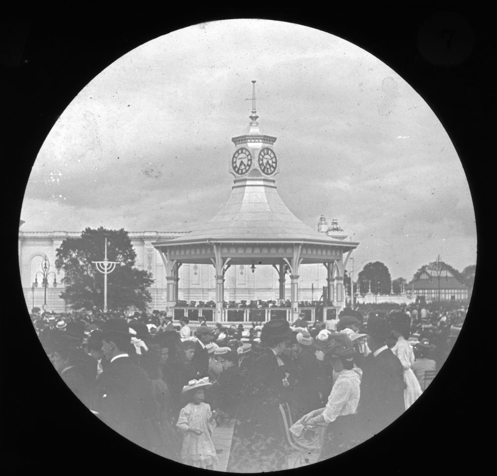 "Bandstand with throngs of crowds at the International Irish Exhibition held in Dublin in 1907. Note the little girl in the front of the picture, RCB Library ""Killaloe"" LS/ Industrial Exhibition 4."