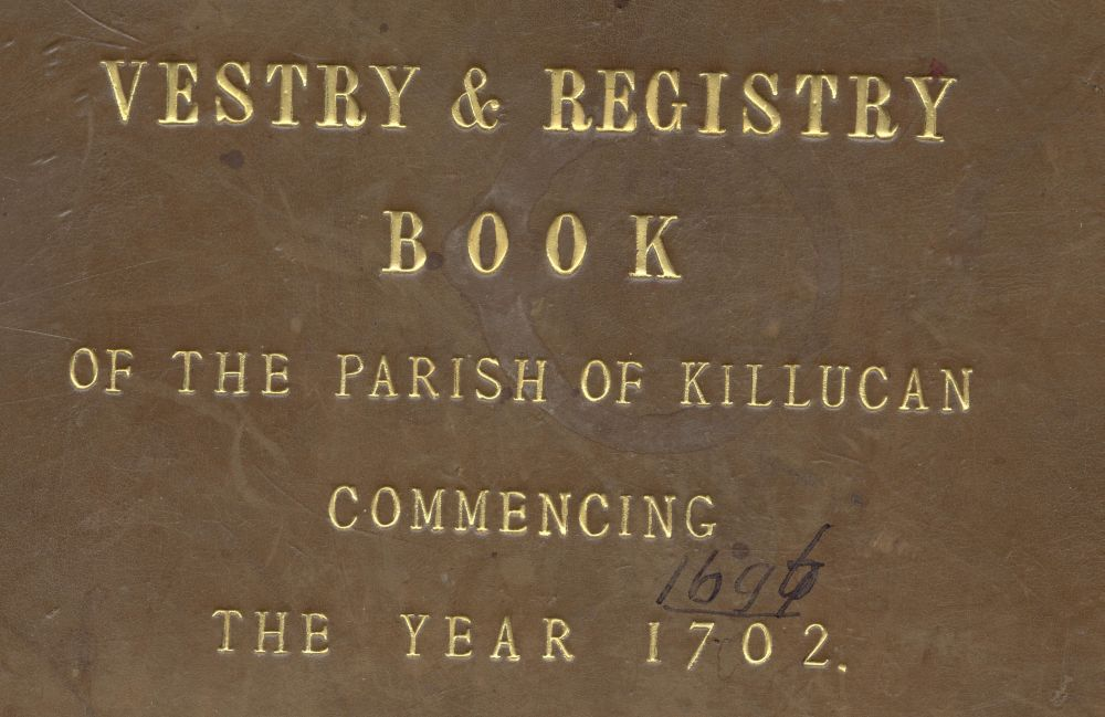 Gold leaf on vellum cover of the earliest and combined register of Killucan parish.