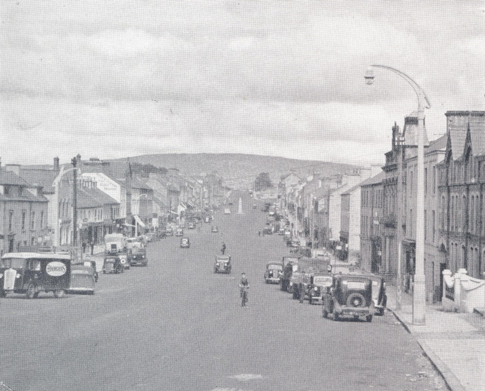 Cookstown's distinctive wide and long Main Street, as it appeared in the early 20th century, from the Tyrone County Handbook (produced by Tyrone County Council)