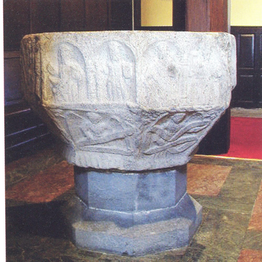 The medieval font in St Peter's