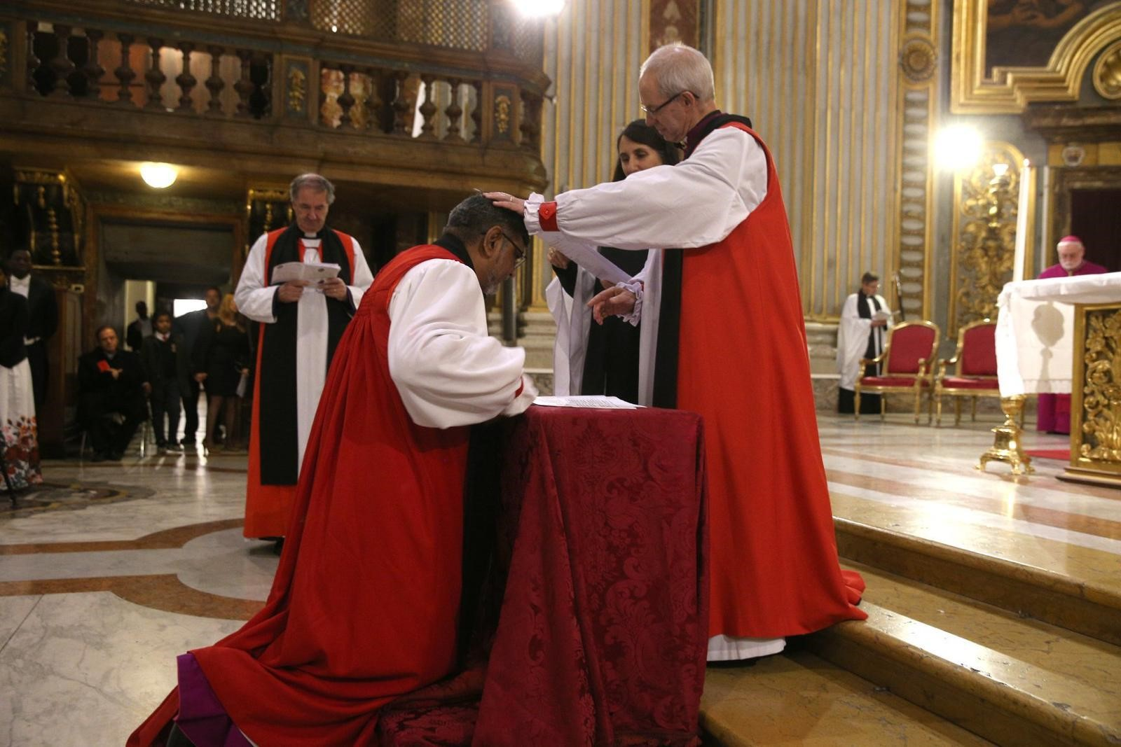 Archbishop Ian Ernest being commissioned as Director of the Centre by the Archbishop of Canterbury, the Most Revd Justin Welby, as Bishop Michael Burrows looks on in November 2019.