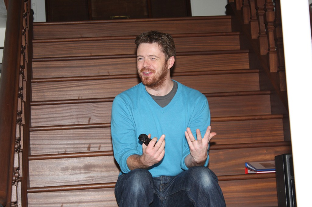 Revd Chris Bennett shares the Dock story from the staircase of the Nomadic (Credit: Annette McGrath)