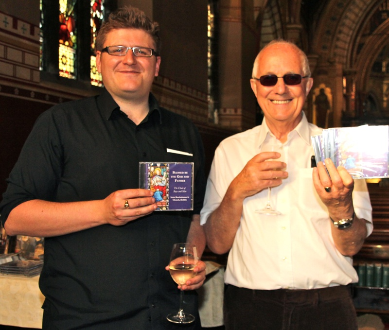 Director of Music at St Bartholomew's, Tristan Russcher and Bobby Barden, member of the choir