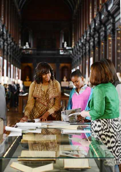 Michelle Obama and daughters view parish records at TCD