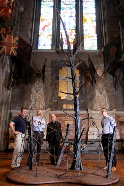 Edward Bisgood of Bushy Park Ironworks, cathedral administrator Gavan Woods, Dean Victor Stacey and education officer Andrew Smith at the new 'Tree of Remembrance' in St Patrick's Cathedral.